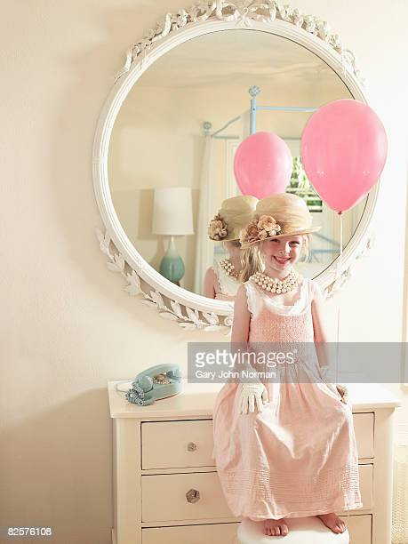 Holding pink balloon young girl in fancy dress