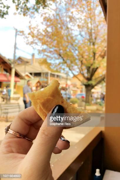 holding pão de queijo - queijo stock pictures, royalty-free photos & images
