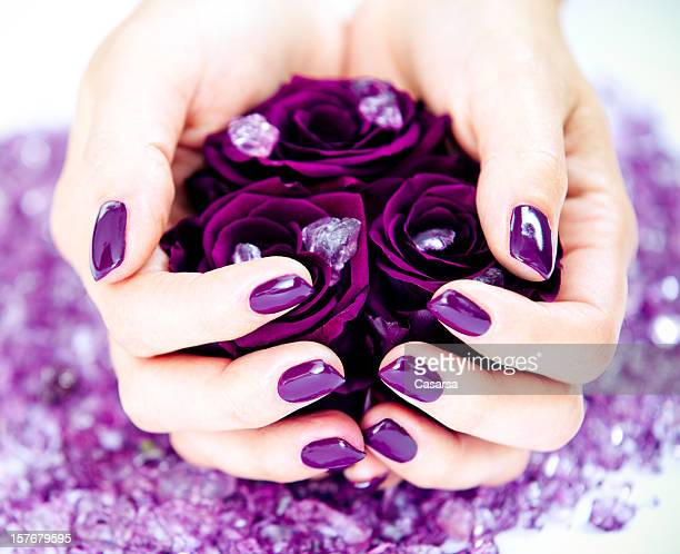 Holding purple roses
