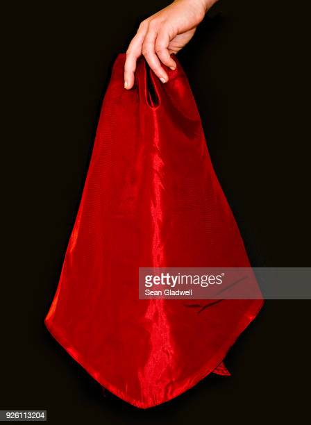 holding red cape - satin stock pictures, royalty-free photos & images