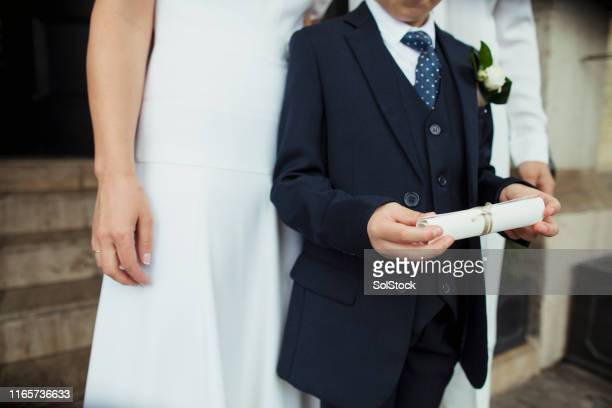 holding romantic wedding vows - pageboy stock pictures, royalty-free photos & images