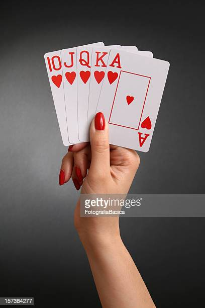 holding royal flush - playing cards stock photos and pictures