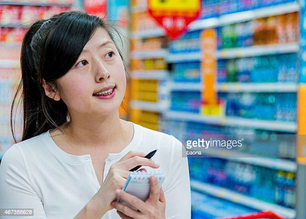 holding shopping list
