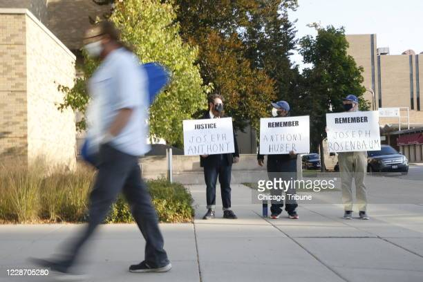 Holding signs, left to right, Matt Muchowski of Waukegan, Vance Wyatt of North Chicago, and Donald Blake of Waukegan hold signs outside the Lake...