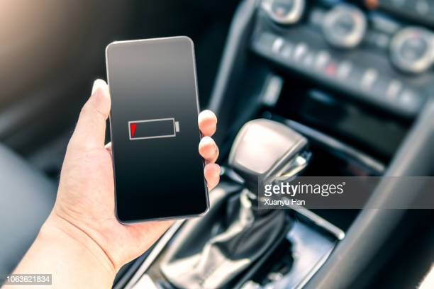 holding smartphone in car