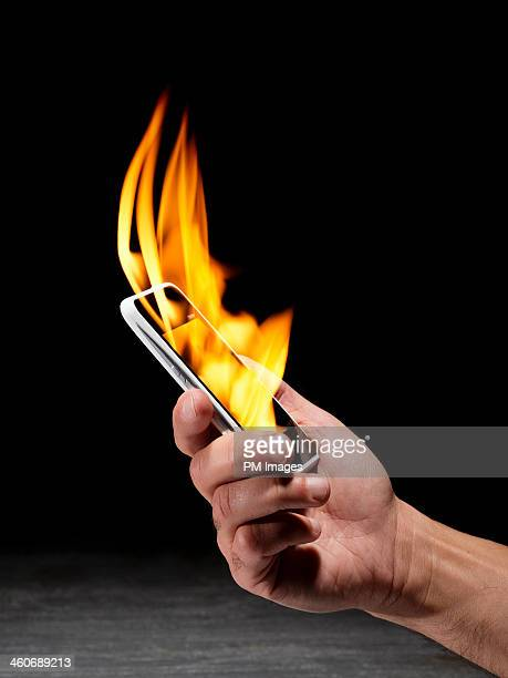 Holding smartphone on fire