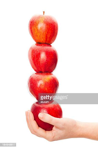 holding stack of apples - royal gala apple stock photos and pictures