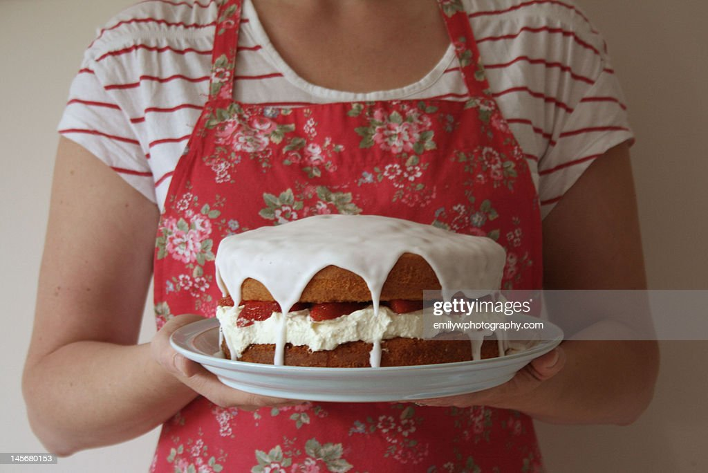Holding strawberry sponge cake. : Stock Photo