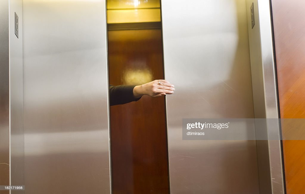 ... Holding the elevator door ... & Free holding door Images Pictures and Royalty-Free Stock Photos ...