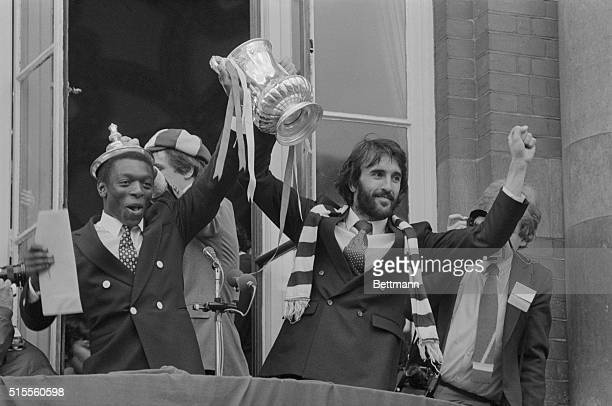Holding the FA Cup between them in victory left Garth Crooks who scored one of the winning goals and right Ricardo Villa who scored two for Tottenham...