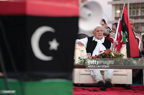 Holding the flags of Turkey and the Libyan rebellion, Mohammed Omar al-Mukhtar, the 90-year-old son of Libya's anti-colonialist resistance hero Omar...