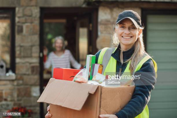 holding the groceries - volunteer stock pictures, royalty-free photos & images
