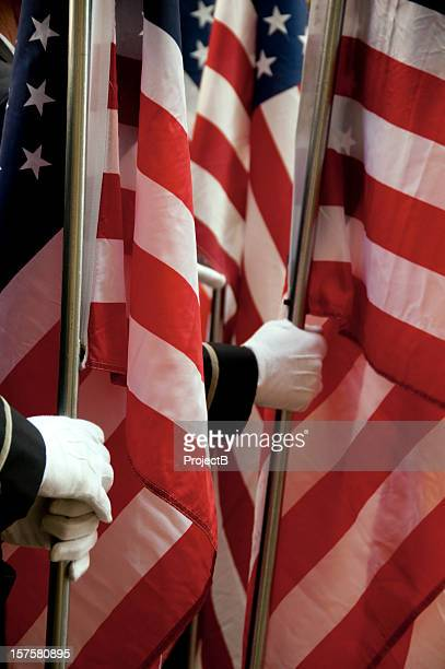 holding the united states of america flags - armed forces day stock pictures, royalty-free photos & images