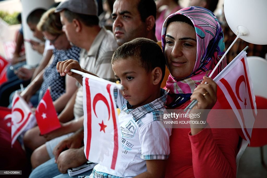 turkish cypriot flag cyprus holding army northern greece nicosia attend military embed turkey july island gettyimages getty