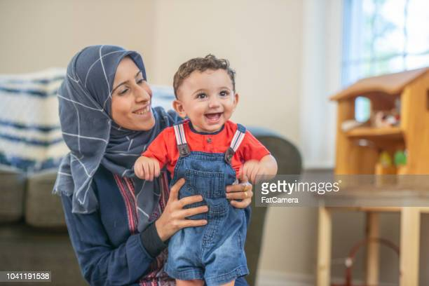 holding toddler - syria stock pictures, royalty-free photos & images