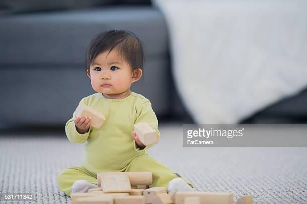 Holding Toy Blocks