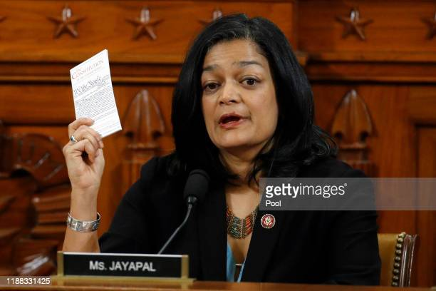 Holding up a copy of the U.S. Constitution, Rep. Pramila Jayapal, D-Wash., votes to approve the second article of impeachment as the House Judiciary...