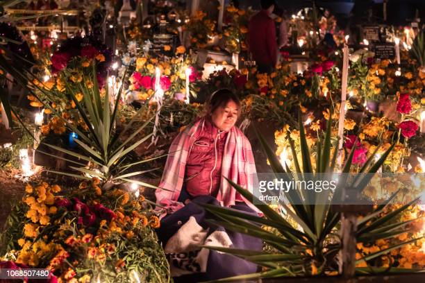 holding vigil in the cemetery in san agustin etla on the día de los muertos - oaxaca stock pictures, royalty-free photos & images