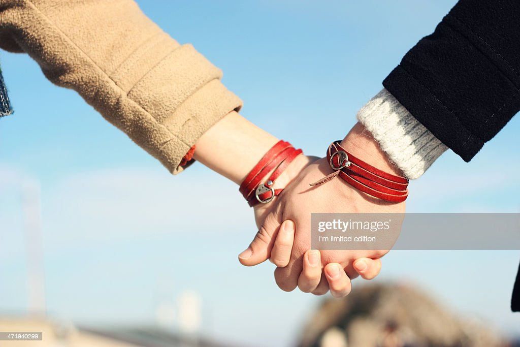 Holding your hand : Stock Photo
