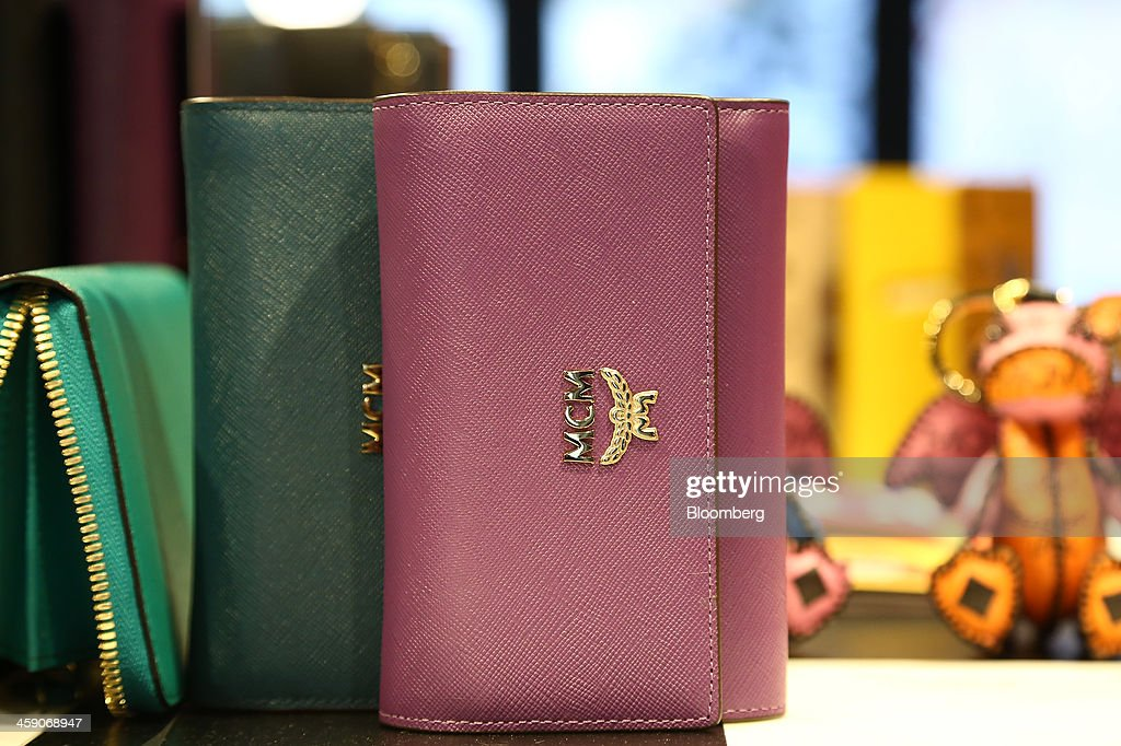 MCM Holdings AG purses are displayed for sale inside the company's store on Garosugil street in the Gangnam district of Seoul, South Korea, on Sunday, Dec. 22, 2013. Consumer prices climbed 0.9 percent in November from a year earlier after a 0.7 percent increase in October that was the smallest gain since July 1999. Photographer: SeongJoon Cho/Bloomberg via Getty Images