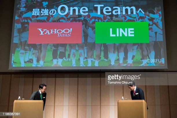 Holdings Corp CEO Kentaro Kawabe and Line Corp CEO Takeshi Idezawa bow during a joint press conference on November 18 2019 in Tokyo Japan Z Holdings...