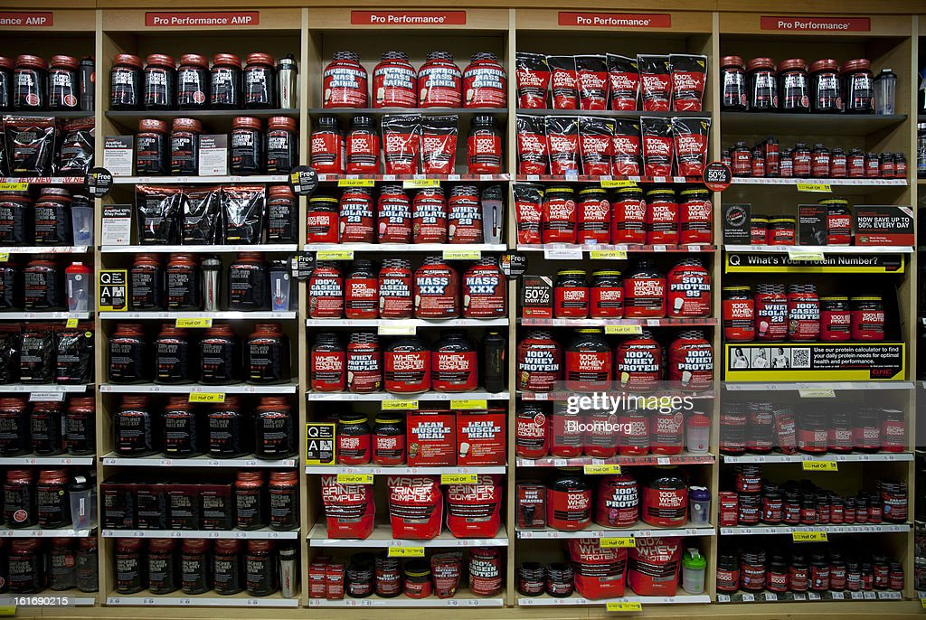 GNC Holdings Inc. weight gaining powder and dietary supplements are displayed for sale at a store in New York, U.S., on Thursday, Feb. 14, 2013. GNC Holdings Inc., a retailer of health and wellness products, reported revenue increases of 10.9% in the fourth quarter and 17.3% for the full year. Photographer: Jin Lee/Bloomberg via Getty Images