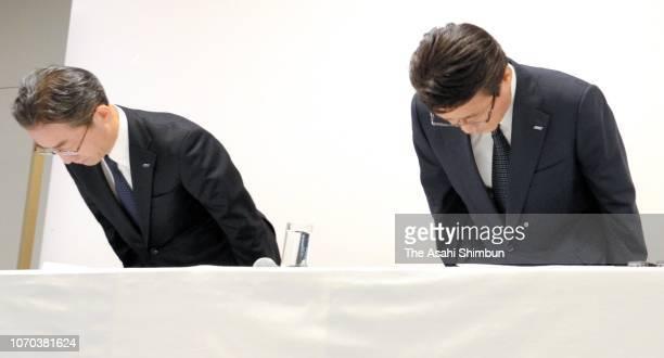 ANA Holdings President Shinya Katanosaka and All Nippon Airways President Yuji Hirako bow for apology during a press conference on November 16 2018...
