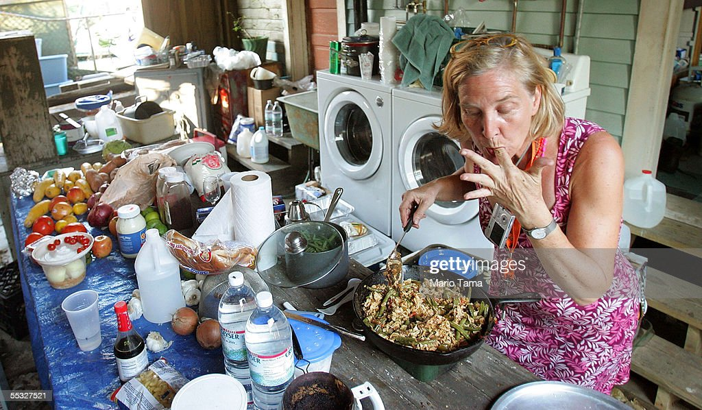 Holdout Holly Gee cooks a meal for other holdouts September 9, 2005 in New Orleans, Louisiana. A group of holdouts in the community have banded together following Hurricane Katrina as they vow to remain in New Orleans despite orders to evacuate. Most in the community feel they are better off staying in their neighborhood than in a faraway shelter.