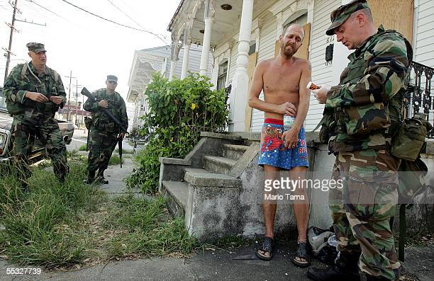 Holdout Kevin Hanson is treated by US Army National Guard soldiers from Oregon September 9 2005 in New Orleans Louisiana Hanson has been unable to...