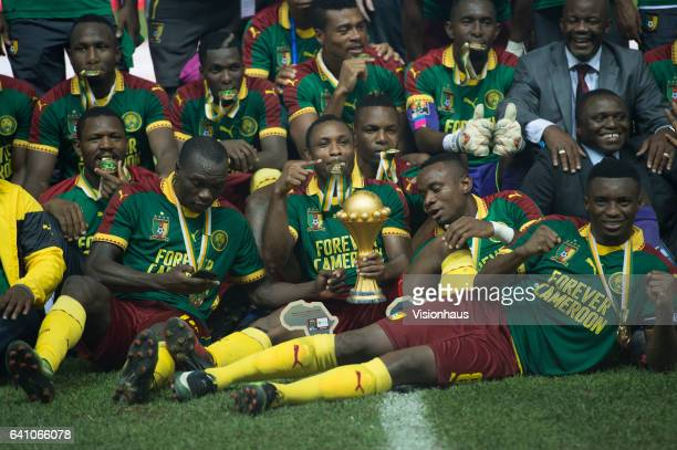 SIANI holds the trophy as Cameroon celebrate winning the CAN 2017 FINAL between Cameroon and Egypt at Stade de L'Amitie on February 05 2017 in...