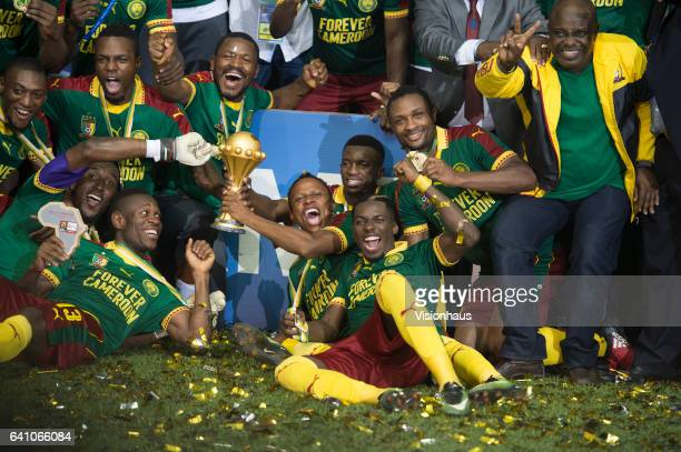 NJIE holds the trophy as Cameroon celebrate winning the CAN 2017 FINAL between Cameroon and Egypt at Stade de L'Amitie on February 05 2017 in...