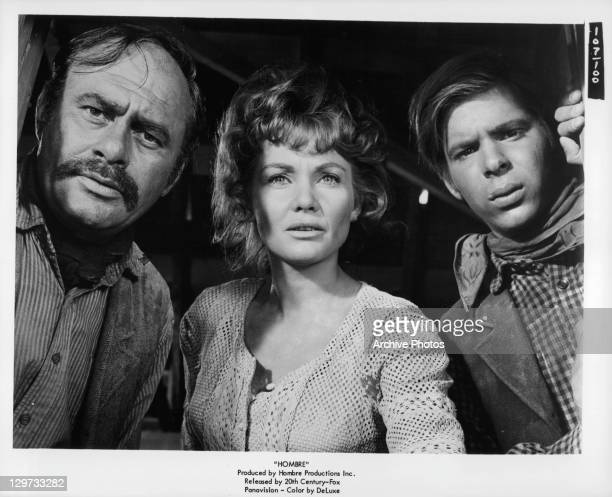 Holdup victims Martin Balsam Diane Cilento and Peter Lazer are stunned by the actions of their in a scene from the film 'Hombre' 1967