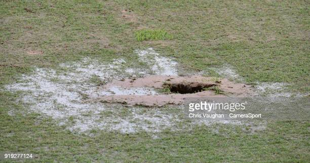 A hole appears in Doncaster Rovers Keepmoat Stadium pitch after the water sprinklers were switched on prior to the Sky Bet League One match between...