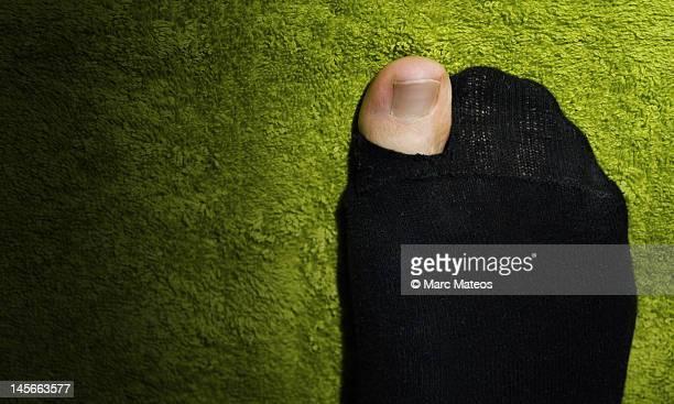 hole in black sock - marc mateos fotografías e imágenes de stock