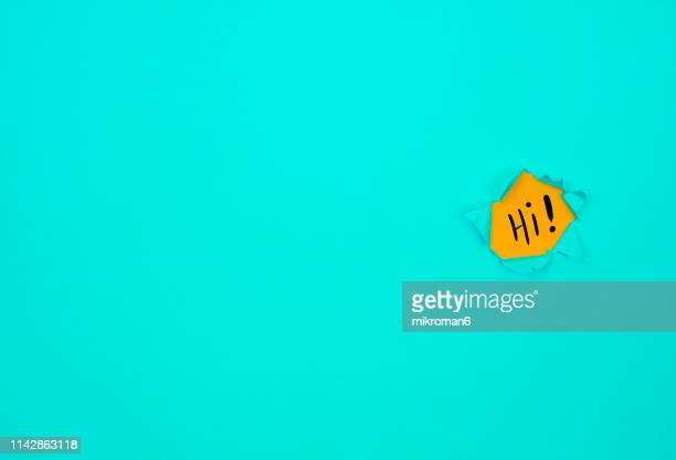 hole in blue page - greeting stock pictures, royalty-free photos & images