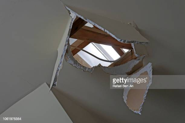 hole in ceiling - house collapsing stock pictures, royalty-free photos & images
