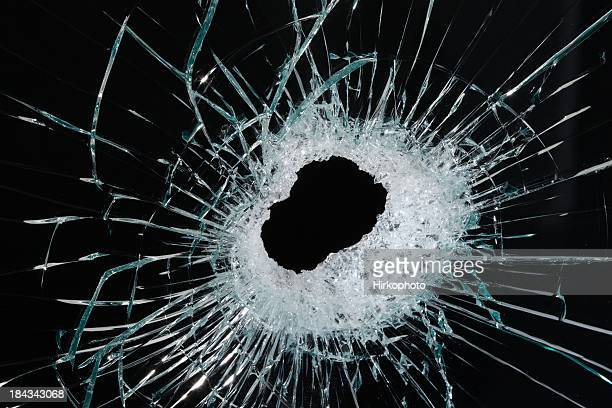 Hole in glass close up