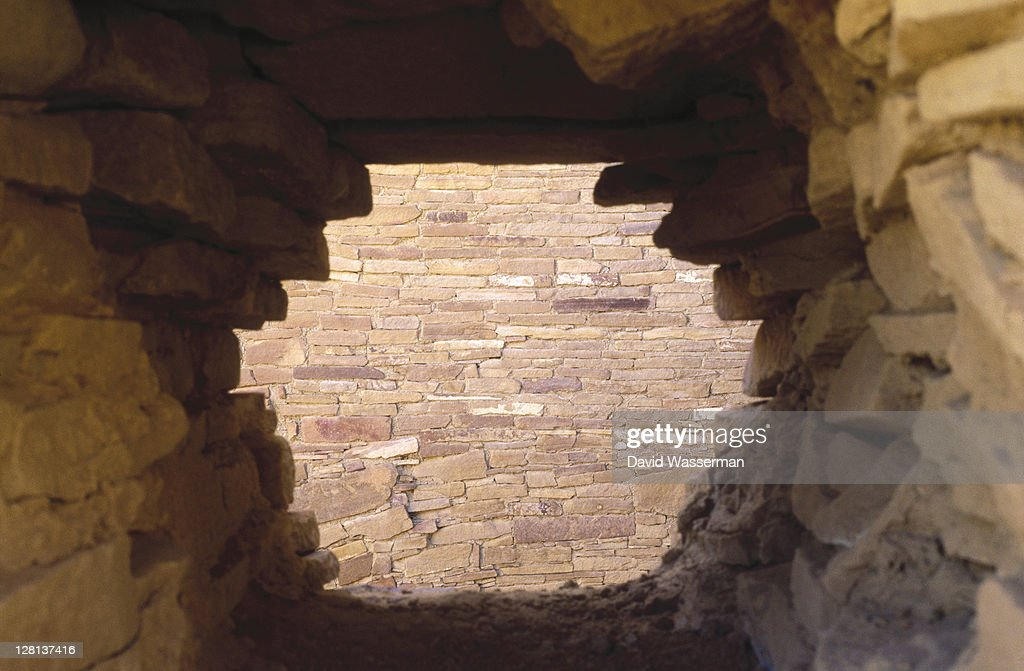 Hole in stone wall : Stock Photo