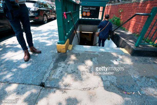 A hole in the sidewalk near a subway entrance was said to be a possible entrance for a rat burrow by Rick Simeone director of pest control for New...