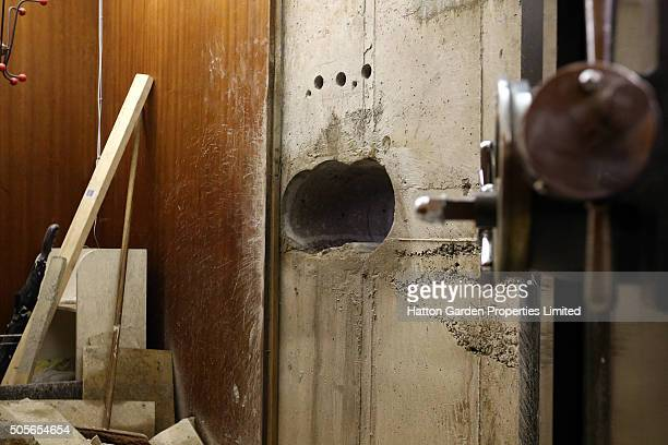 Hole is pictured after having been re-drilled in the wall used by burglars to access the underground vault of the Hatton Garden Safe Deposit Company...