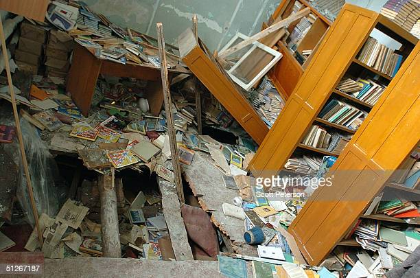 A hole is seen in the floor of a library inside a school September 6 2004 in Beslan southern Russia More than 350 people died after Chechen militant...