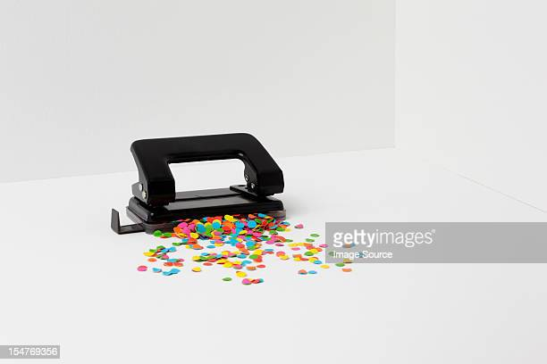 Hole puncher with multi coloured paper