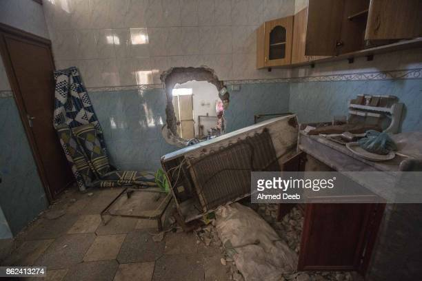 Hole smashed through the wall between two civilian houses made by the Islamic State militants to enable them to move discreetly from one region to...