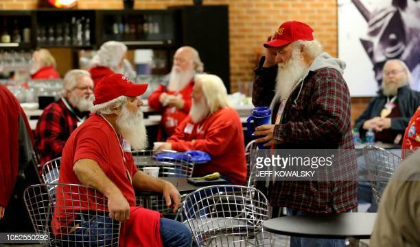 Holes Kimble of Farmer City Illinois and John Jones of Pahrump New York have coffee before the start of Santa School on October 19 2018 in Midland...