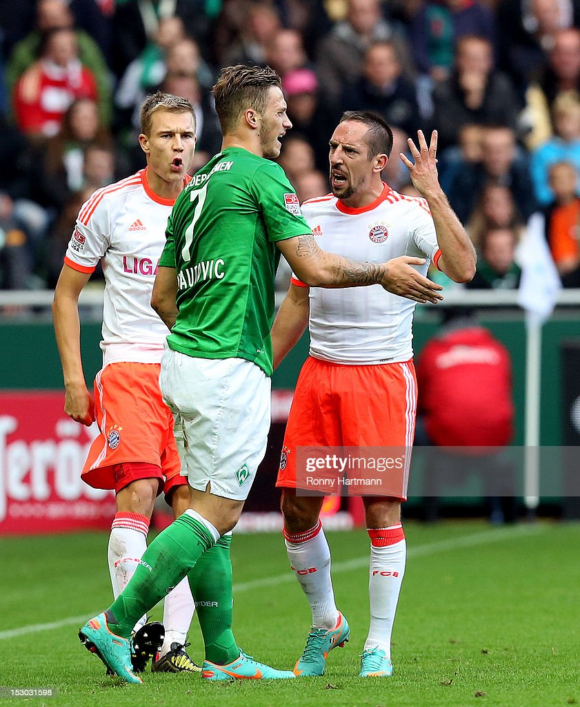 Holger Badstuber (L) and Franck Ribery (R) of Muenchen discuss with Marko Arnautovic of Bremen during the Bundesliga match between Werder Bremen and Bayern Muenchen at Weser Stadium on September 29, 2012 in Bremen, Germany.