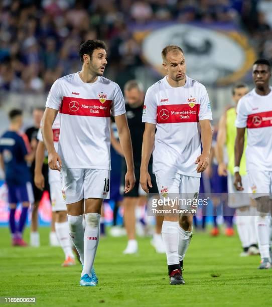 Holger Badstuber and Hamadi Al Ghaddioui of Stuttgart react after the Second Bundesliga match between FC Erzgebirge Aue and VfB Stuttgart at...
