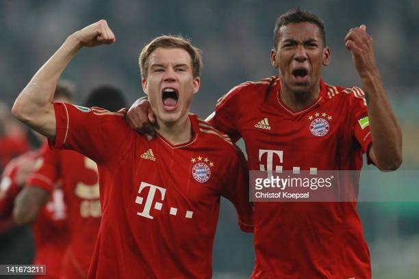 Holger Badstuber and Jérome Boateng of Bayern celebrate the 42 victory after penalty shootout after the DFB Cup semi final match between Borussia...