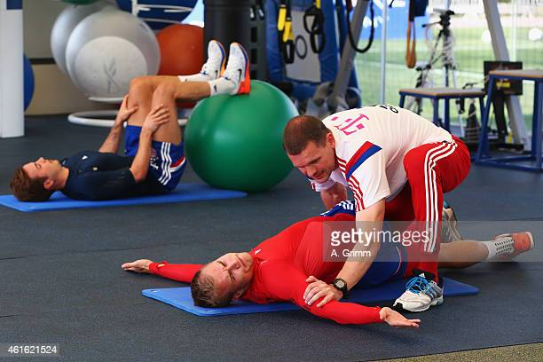Holger Badstuber and Mario Goetze exercise in the gym with physiotherapist Holger Broich during day 7 of the Bayern Muenchen training camp at ASPIRE...