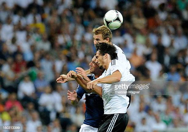Holger Badstuber and Mats Hummels of Germany battles for the ball with Gonzalo Higuain of Argentina during the international friendly match between...