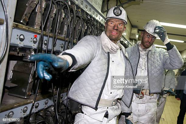 Holger Badstuber and Ralf Faehrmann pose during a visit of FC Schalke 04 at Prosper Haniel Mine on January 18 2017 in Bottrop Germany